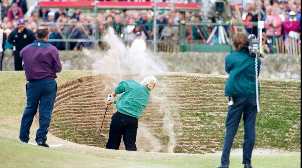 Daly splashes out of the Road Hole bunker at St. Andrews.