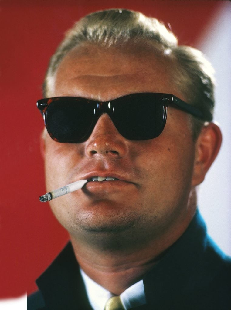 Golf: Closeup portrait of Jack Nicklaus wearing Masters green blazer and sunglasses with cigarette in mouth. West Palm Beach, FL 2/10/1967  SET NUMBER:  X12203 CREDIT: Walter Iooss Jr.