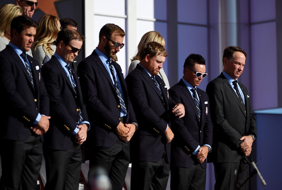 Members of the American team bow their heads during the Opening Ceremony.