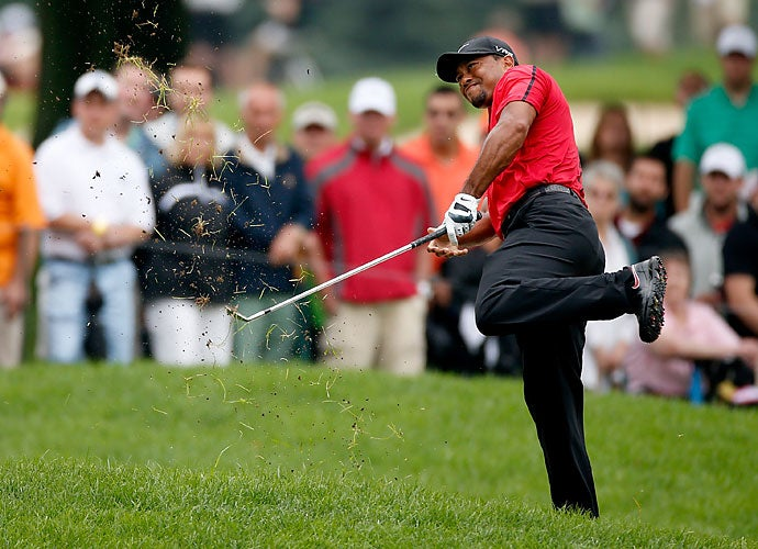 The next month would see Tiger finish 69th at the British Open. He finished, though, which is more than he could say following the WGC-Bridgestone Invitational in late July, where this bunker shot tweaked Woods' back once again. He had to pull out of a Sunday round for the second time in 2014.