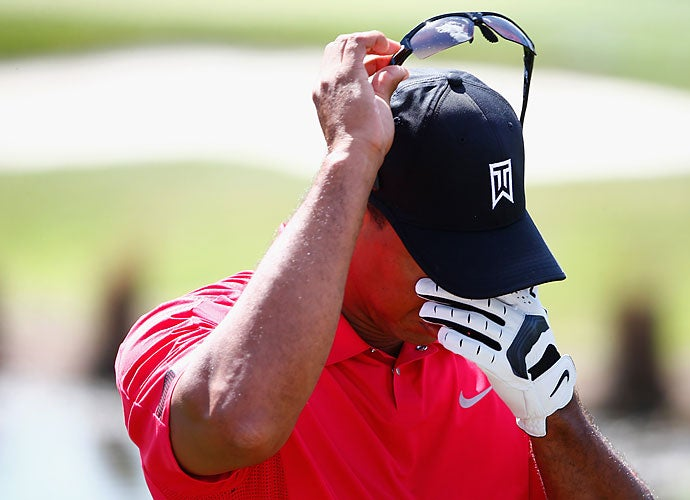 It wouldn't last long, though. Woods couldn't even finish his Sunday round, citing back spasms as he withdrew from the event. The spasms began during this pre-round warm-up and sent him from the course with just five holes remaining.