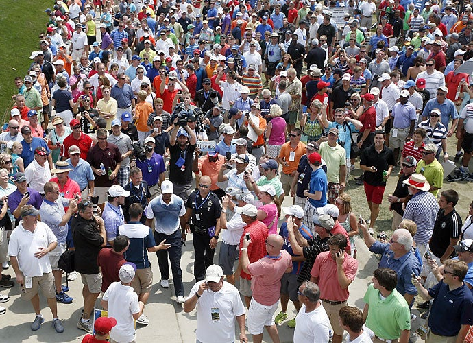Fans sure took notice, as they followed Woods in throngs during his practice round. Rest assured, the group wasn't there to watch Harris English play with Steve Stricker. It was about all the excitement that Woods could conjure up, however, missing the cut with two rounds of 74.