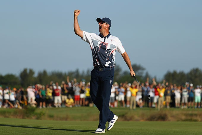 Justin Rose celebrates on the 18th green.