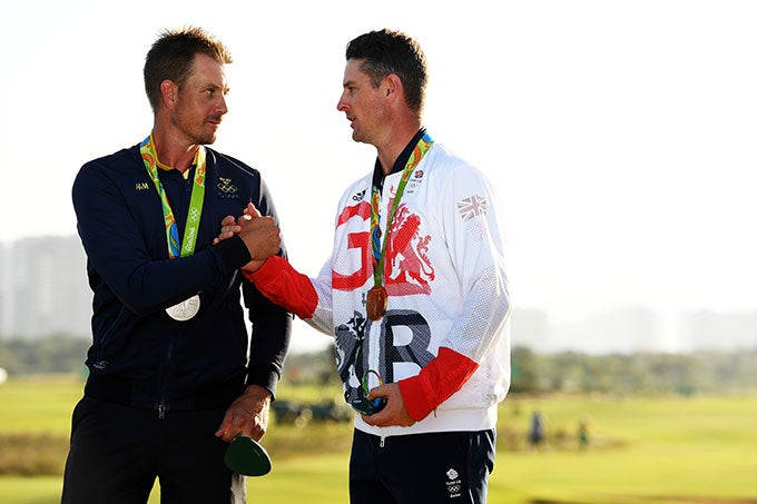Justin Rose and Henrik Stenson with their gold and silver medals.