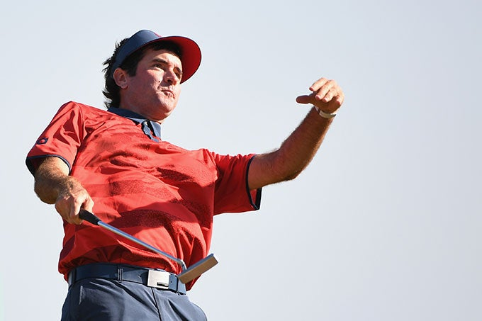Bubba Watson throws ball into the crowd on the 72nd hole.