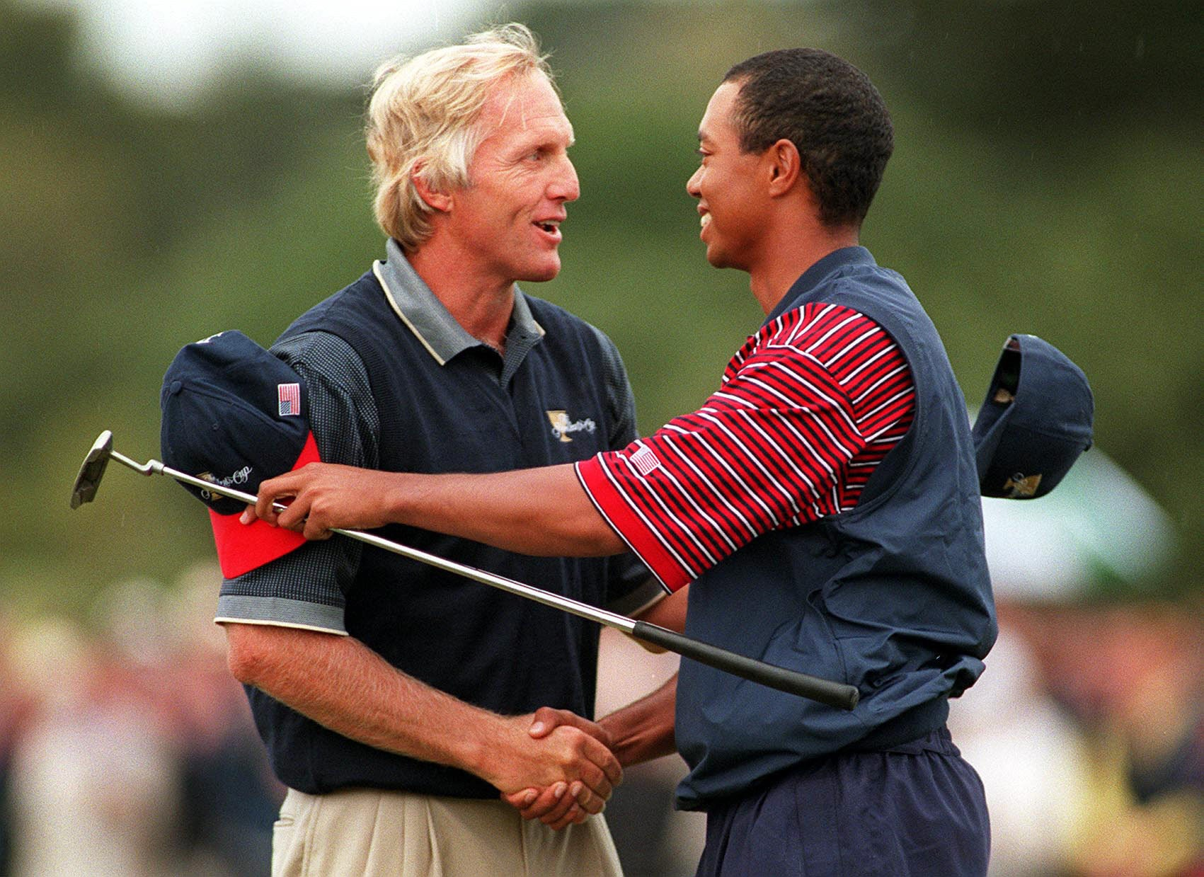 Greg Norman, Tiger Woods.jpg