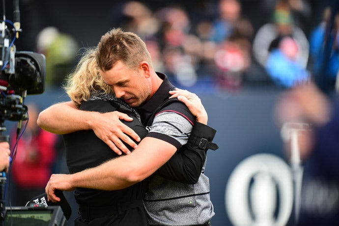 Stenson embraces his wife following his victory.