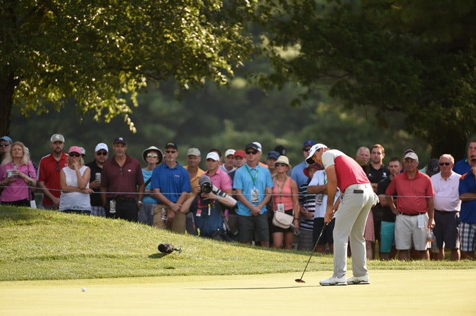 Jason Day putts on the 12th hole.
