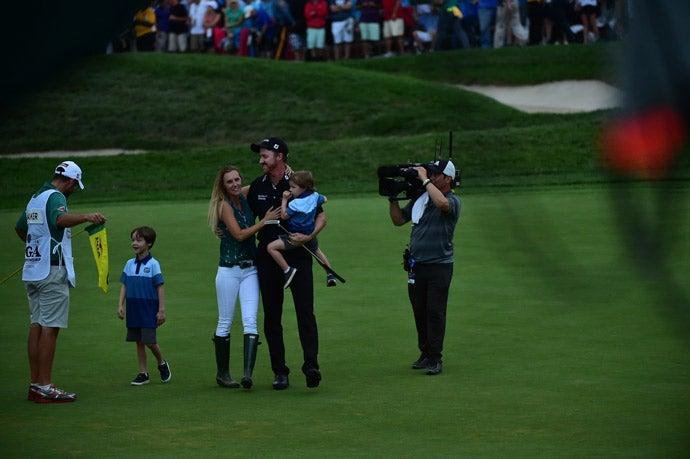Walker celebrated with his family on the 18th green after his victory.