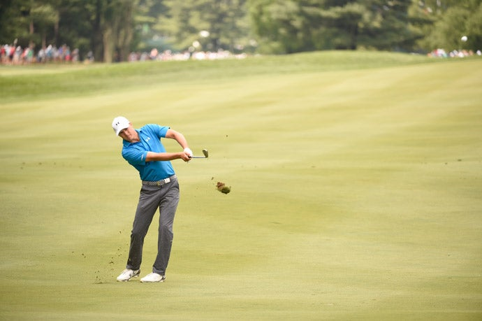 Jordan Spieth hits an iron during the second round.
