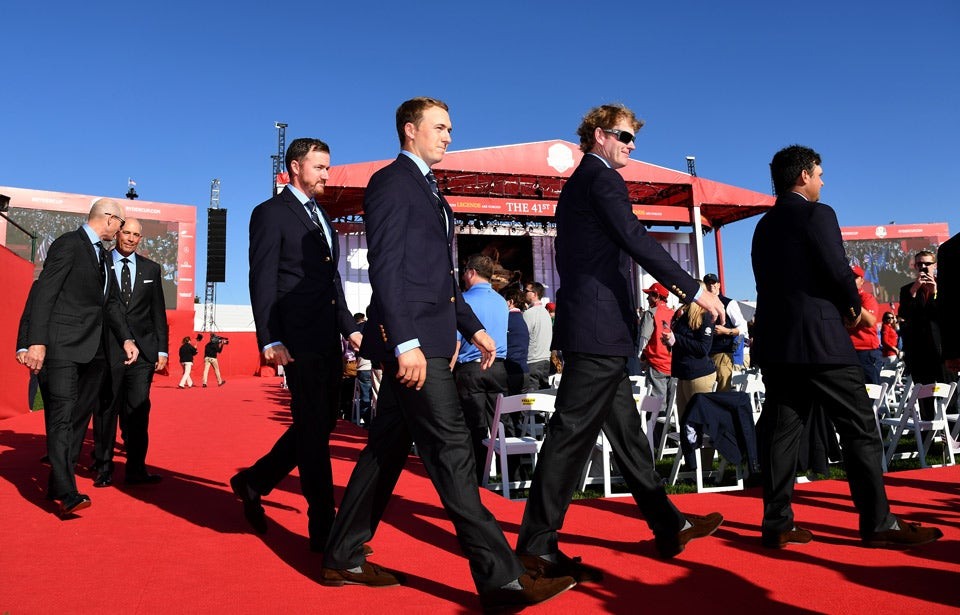 Jordan Spieth, Jimmy Walker and other American team members arrive at the ceremony.