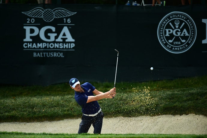 Martin Kaymer hits out of a bunker on Friday.