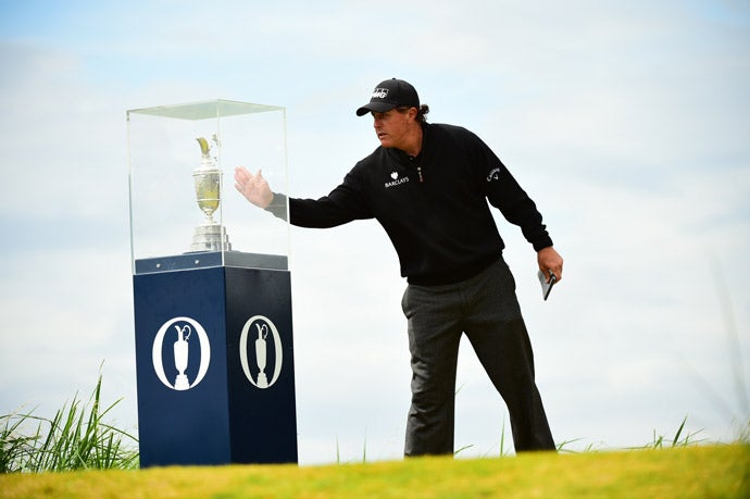 Mickelson takes a look at the claret jug before starting his final round