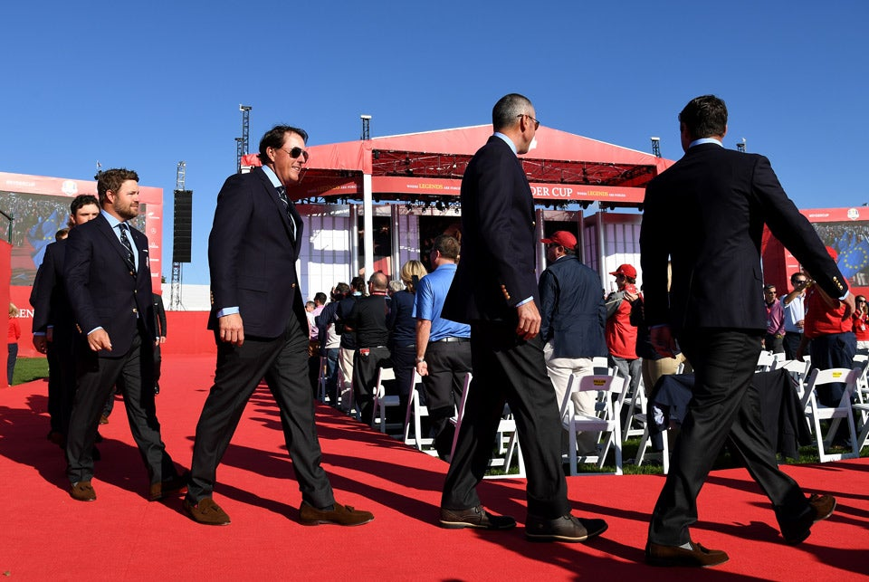 Phil Mickelson and Matt Kuchar proceed into the venue.