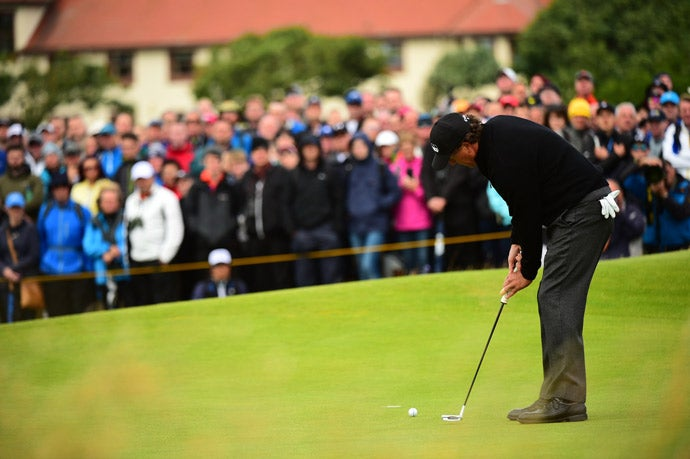 Phil Mickelson putts on Sunday.