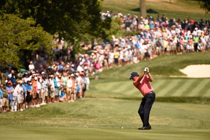 Phil Mickelson hits his second shot on the 3rd hole on Thursday.