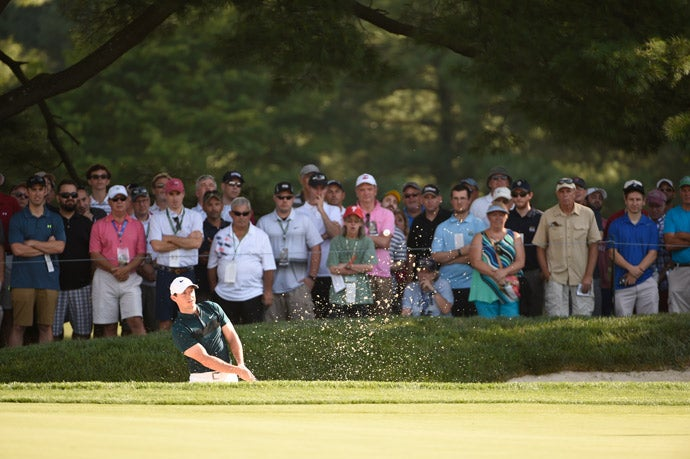 Rory McIlroy hits out of a bunker in round 1.