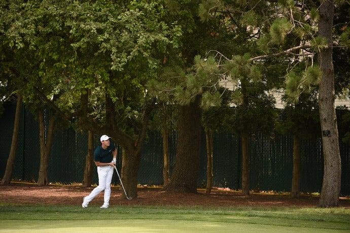 Rory McIlroy hits his second shot on the 2nd hole on Thursday.