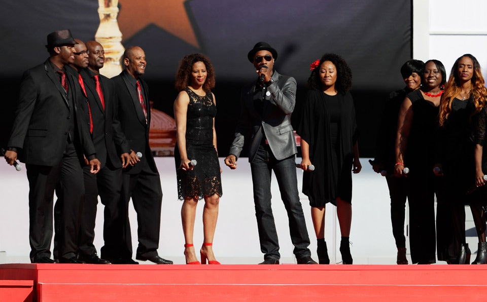 Singer Aloe Blacc performs with Sounds of Blackness at the Opening Ceremony.