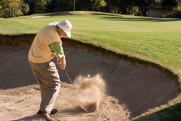 Dave Pelz hitting chunk and run sand shot