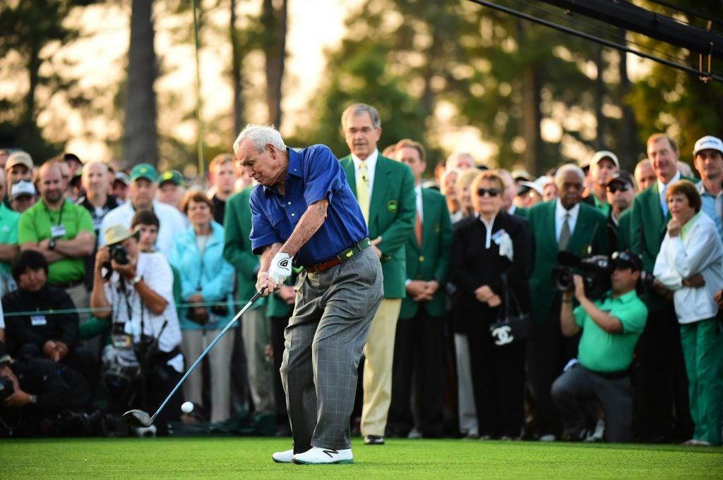 Arnold Palmer hits his tee shot