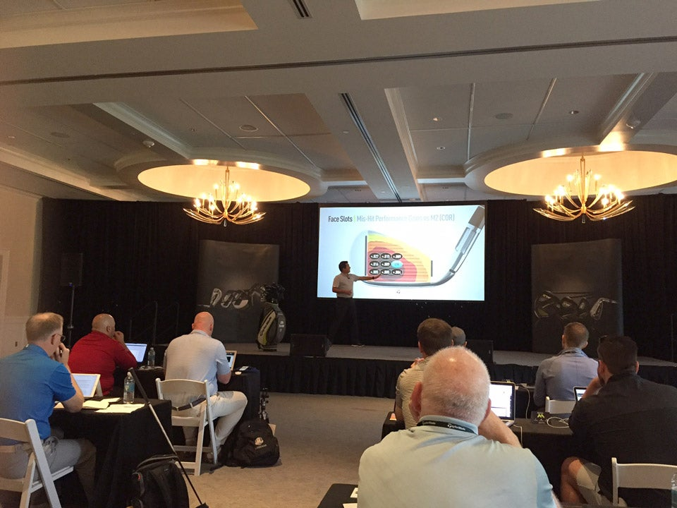 A TaylorMade representative gives a presentation on the new M2 irons.