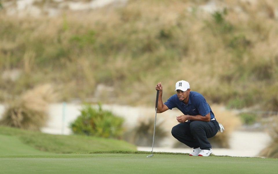 Tiger Woods reads a putt on Friday in The Bahamas.