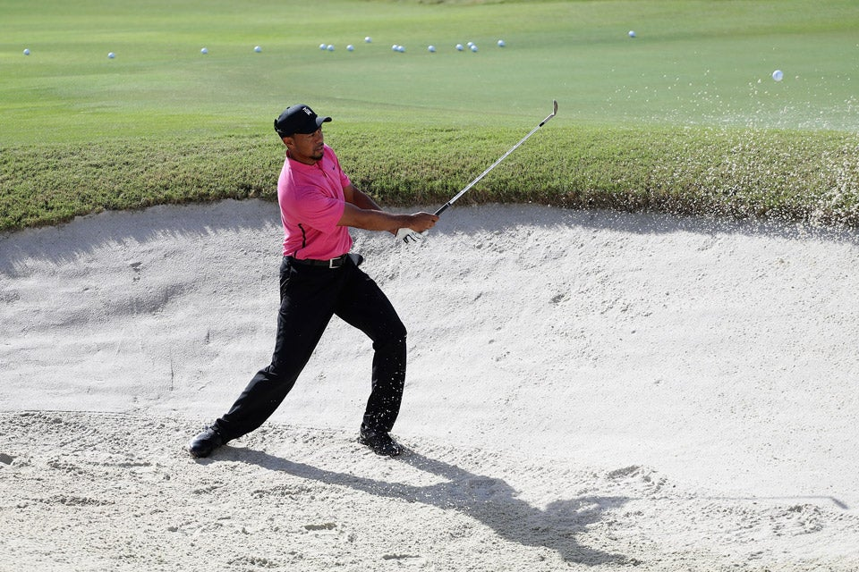 Tiger Woods practices his bunker play on Tuesday at the Hero World Challenge.