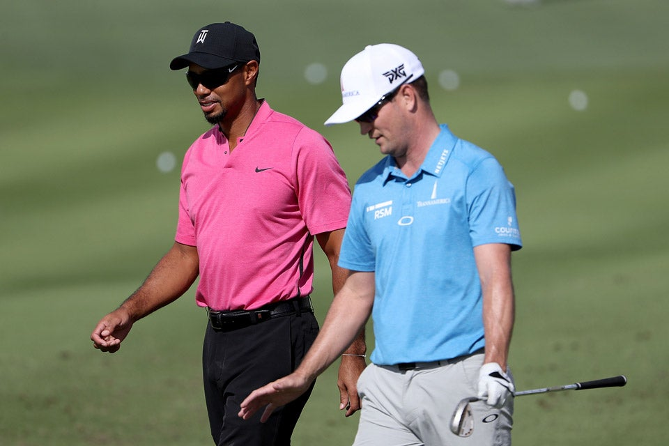 Tiger Woods chats with Zach Johnson on Tuesday.