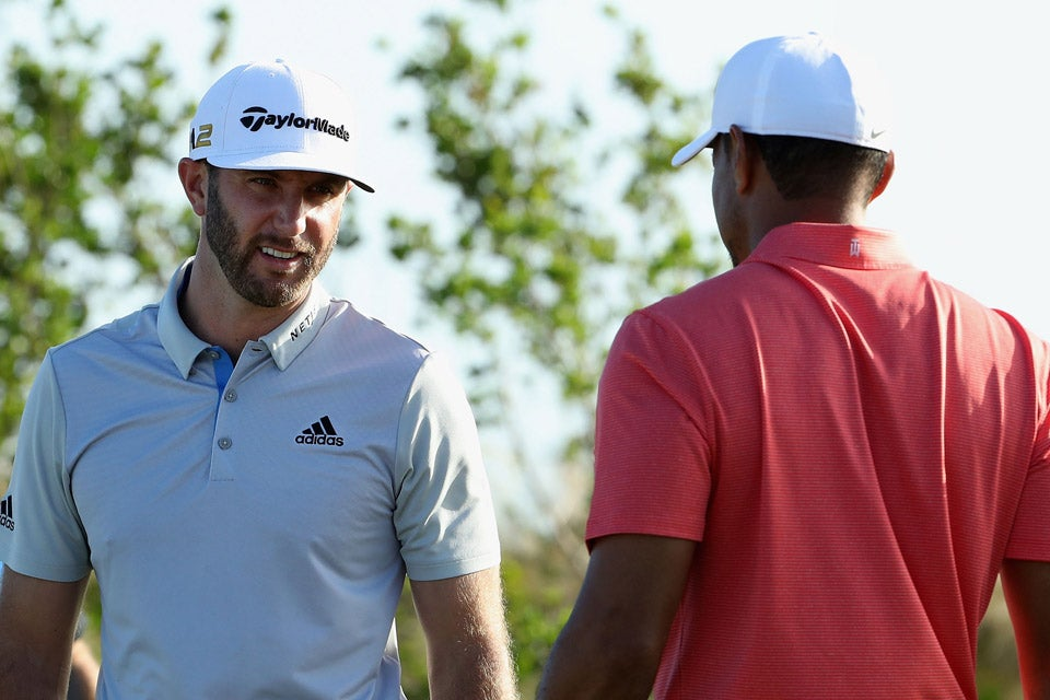 Tiger Woods talks with Dustin Johnson on Wednesday.