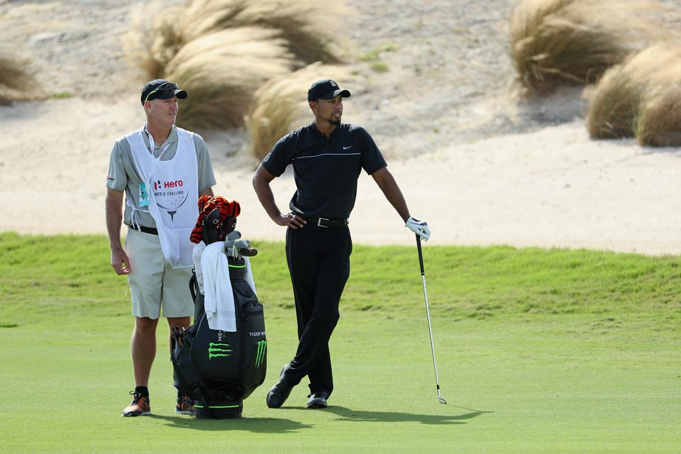 Tiger Woods with caddie Joe LaCava during the first round.