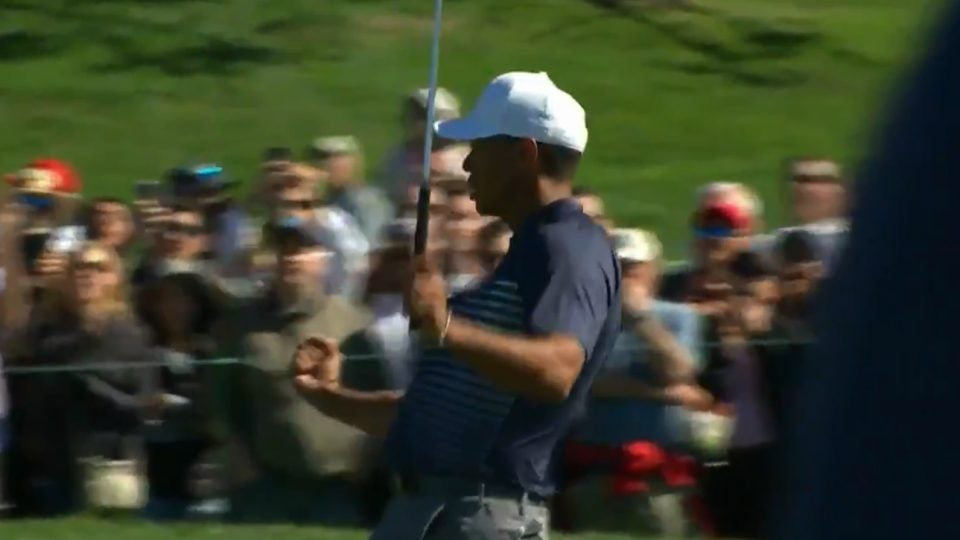 tiger-woods-fist-pump-birdie-farmers.jpg