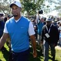 tiger-woods-new-conf-farmers.jpg