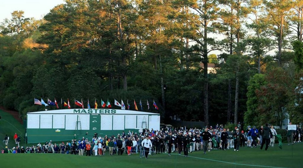 The scoreboard is a popular gathering place at Augusta National.