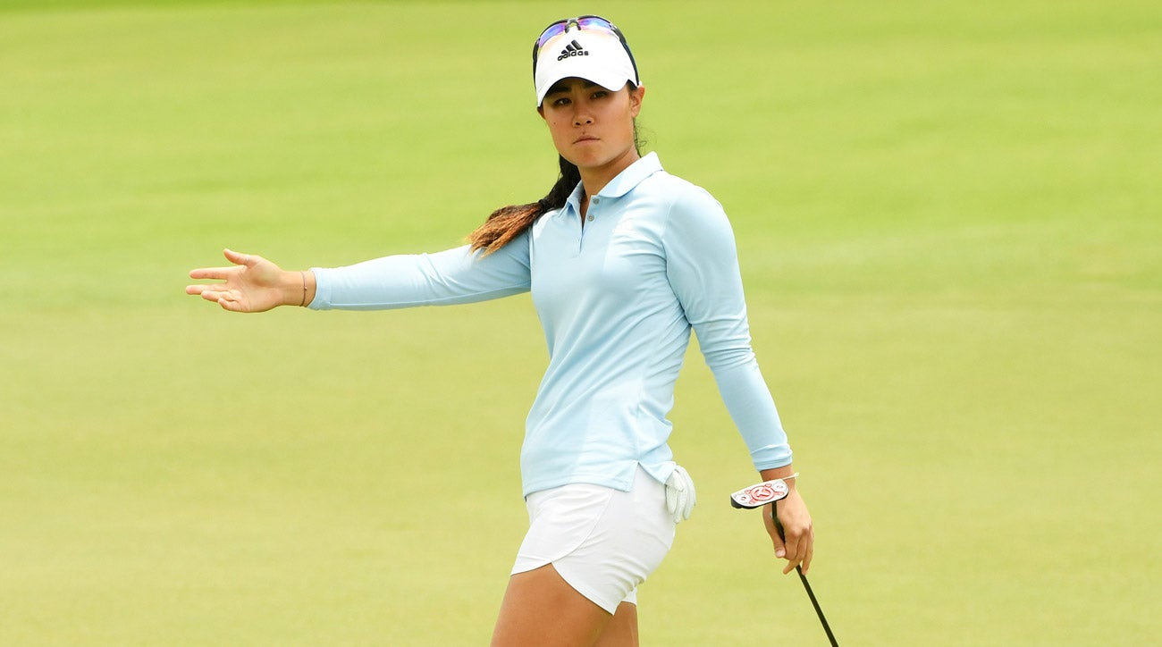 Danielle Kang falls asleep stretching, breaks tooth, shoots 68 in Singapore