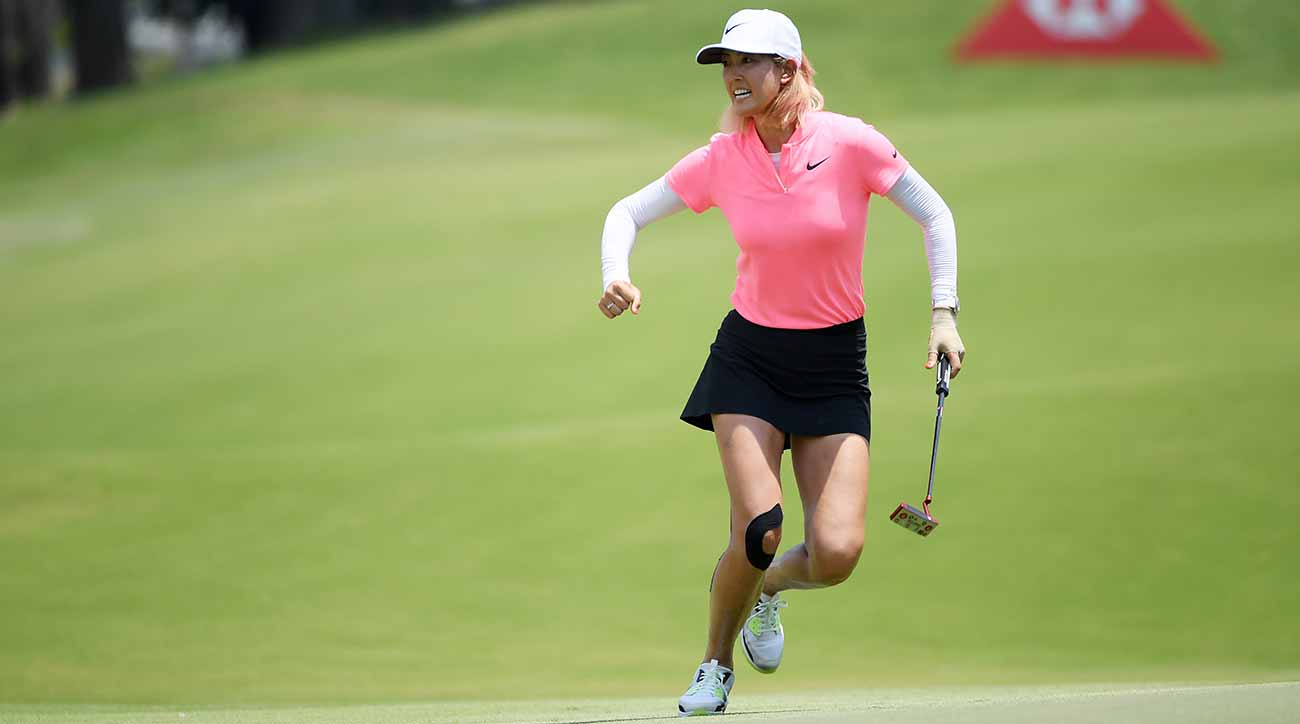 michelle wie sinks long putt on 72nd hole to win in singapore