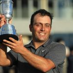 Francesco Molinari hoists the claret jug on Sunday night.