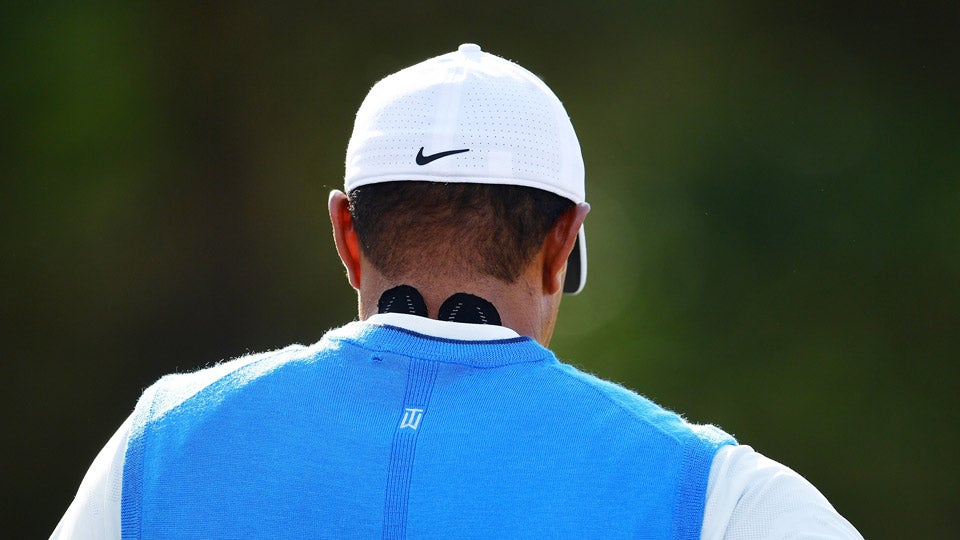 After waking up with a stiff neck, Tiger Woods applied KT Tape for his first round at Carnoustie.