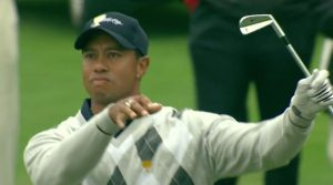 Tiger Woods does club twirl