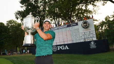 Brooks Koepka lifts the Wanamaker trophy at the 2018 PGA Championship at Bellerive.