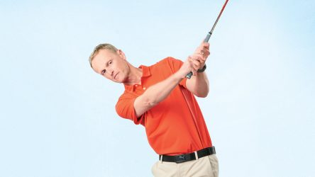 Reverse your grip in practice to groove an iron-crushing hand path.