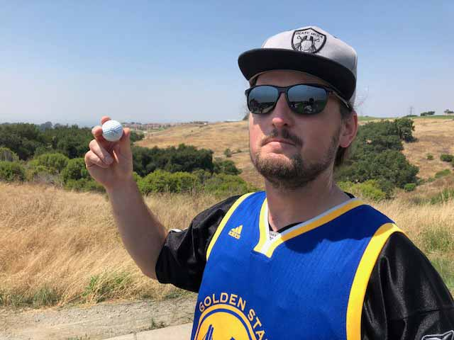 One fo the many Steph Curry fans who got a golf ball from the All-Star.