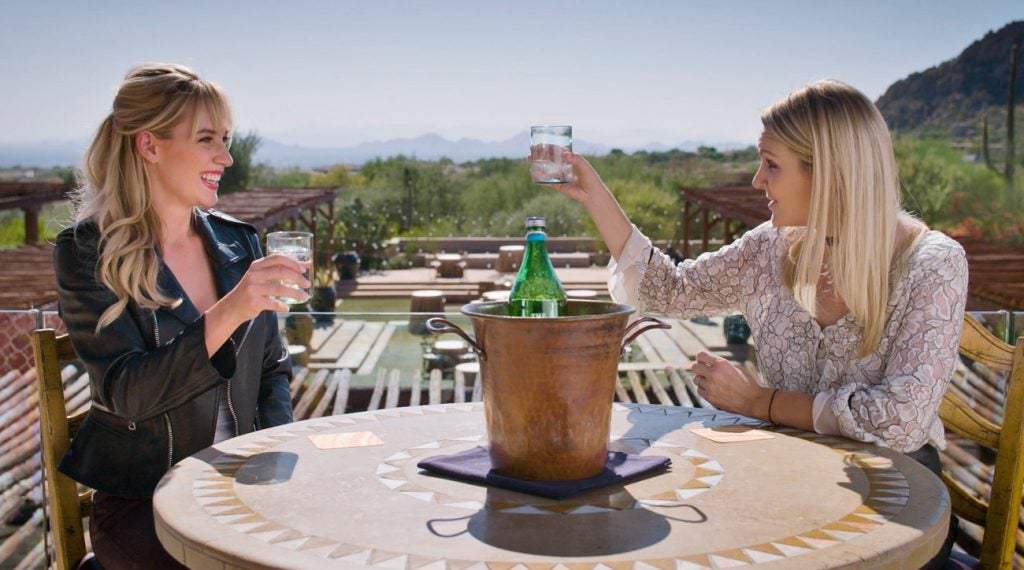 Paige Spiranac enjoys a round of sparkling water with Jessica Marksbury at the Four Seasons Resort in Scottsdale, Ariz.