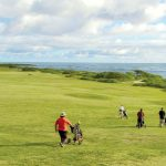 A foursome plays at Kahuku Golf Couse on the North Shore of Oahu in Hawaii.