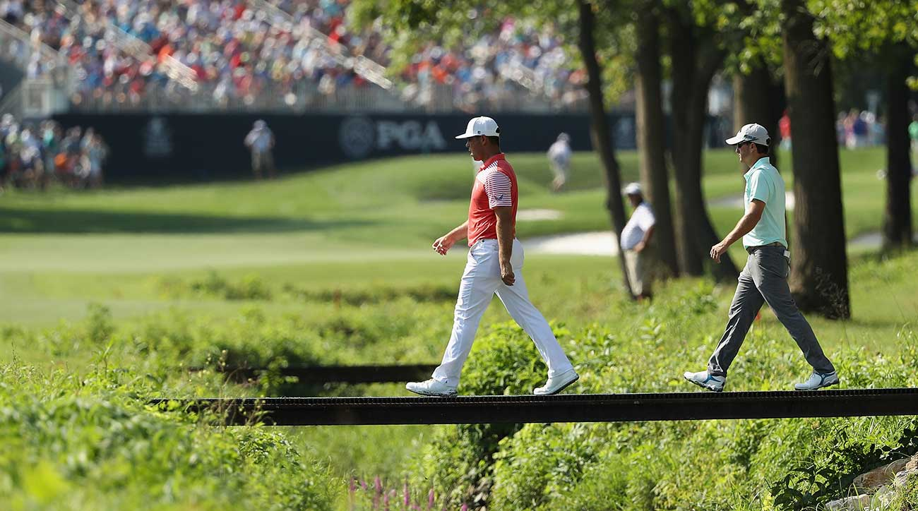 Gary Woodland and Kevin Kisner are in prime position halfway through the 100th PGA Championship.