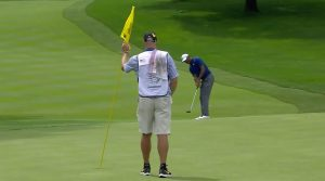 Tiger Woods makes birdie on the 18th hole at Firestone CC.