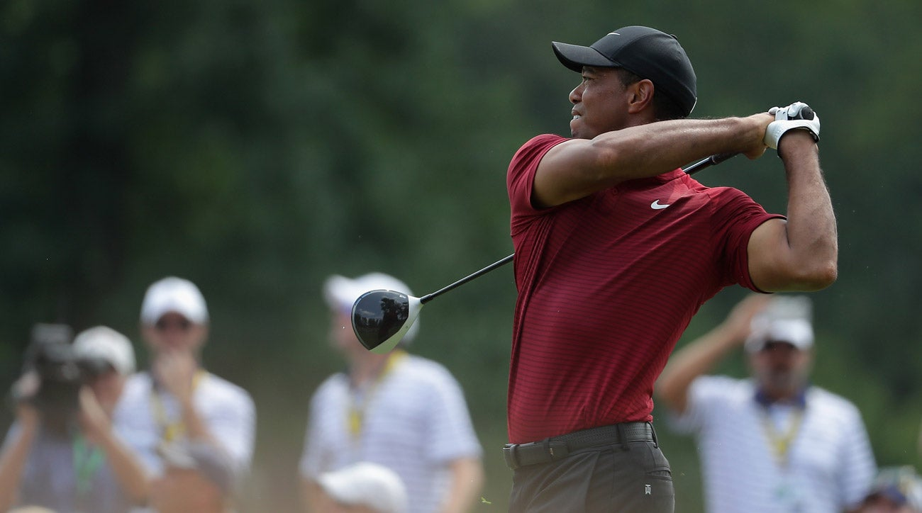 watch  cellphone rings during tiger woods tee shot on