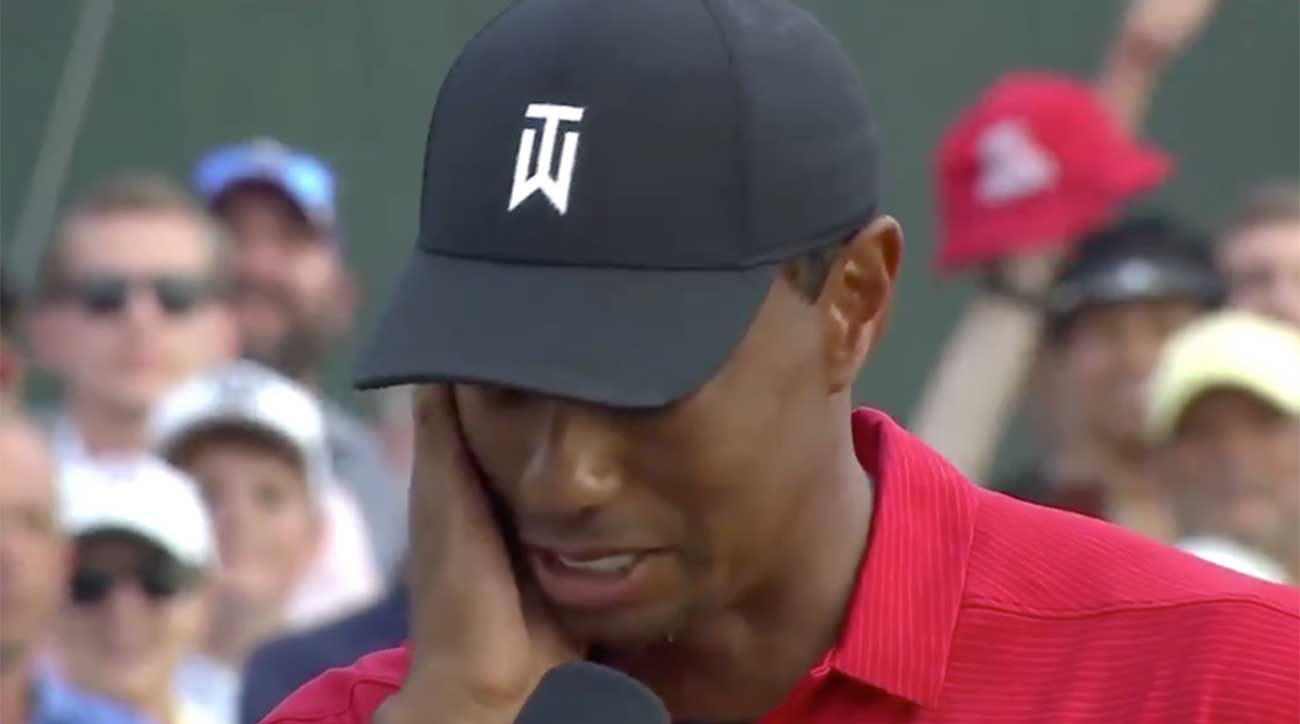 watch  emotional tiger woods fights tears after winning
