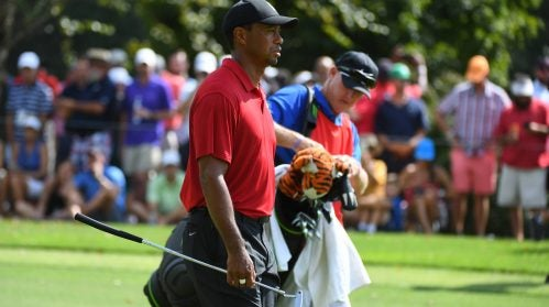 Tiger Woods approaches East Lake's fifth green with caddie Joe LaCava.