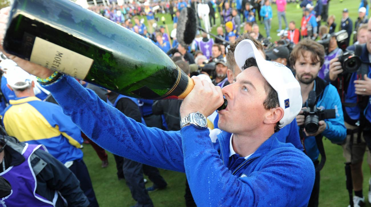 Rory McIlroy enjoys a large bottle of champagne to celebrate